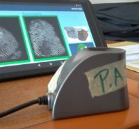 Photo: PATH/Fred Njobvu. The VaxTrac system uses a biometric sensor to record immunizations in the Benin health system.