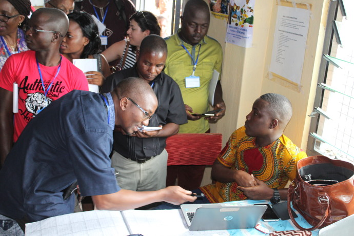 Photo: PATH/Mali Kambandu. BLN members at the third BLN Design Collaborative learn how the Ghana Health Service uses an electronic system to track and report on immunisations during a field visit to Bawjiase Health Centre.
