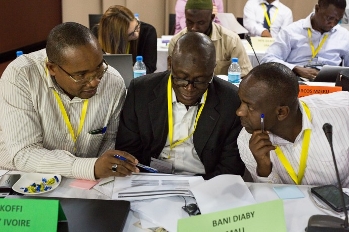 Photo: PATH/Trevor Snapp. Participants review wireframes to help design and provide input around how BID interventions will be packaged for other countries to adopt and use.