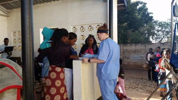 Photo: PATH. The BID Initiative team conducts a time use survey during an immunization session.