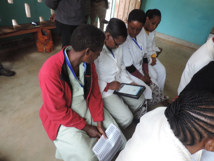 Photo: PATH. Health workers familiarize themselves with the new electronic immunization registry in Arusha City district.