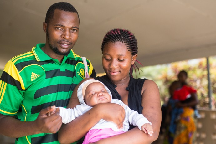 Photo: PATH/Trevor Snapp. A family waits for immunization services at Usa River Health Facility in Arusha, Tanzania.