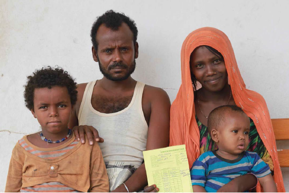 Photo: PATH/Therese Bjorn Mason. Medina Abdul with her husband, Mohamed Musa, her son, Hanfare, and a niece, Yalo District.